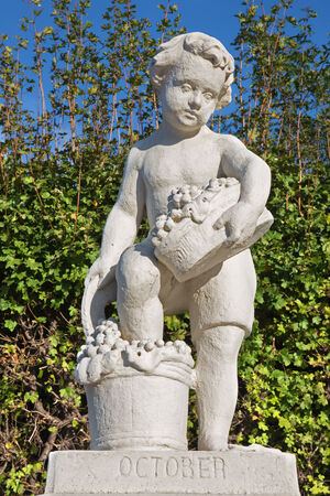 statuary garden: Vienna - The symbolic sculpture of october month in the gardens of Belvedere palace.