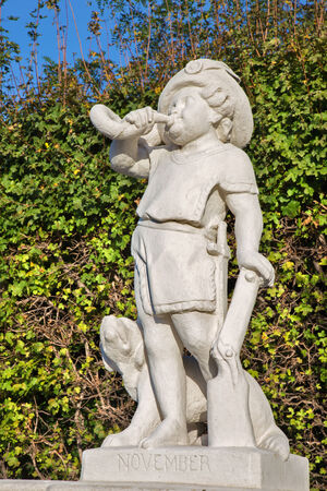 statuary garden: Vienna - The symbolic sculpture of november month in the gardens of Belvedere palace. Editorial