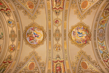 SEVILLE, SPAIN - OCTOBER 29, 2014: The frescos on the ceiling in church Basilica de la Macarena by Rafael Rodrguez (1949) in neobaroque style.