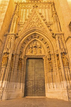 SEVILLE, SPAIN - OCTOBER 28, 2014: The portal Puerta de Bautismo from 15. cent by N. Martinez and J. Norman on the Cathedral de Santa Maria de la Sede.