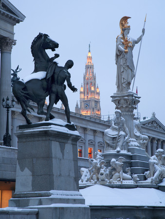 pallas: Vienna - Pallas Athena fountain and parliament in winter evening and Town hall tower in background