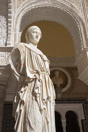 portico: SEVILLE, SPAIN - OCTOBER 28, 2014: The copy of antique statue Pallas Pacifera in the Courtyard of Casa de Pilatos .