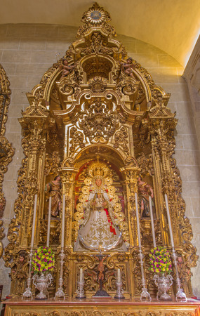 vested: SEVILLE, SPAIN - OCTOBER 28, 2014: The side altar from year 1718 - 1731 by Jose Maestre in baroque Church of El Salvador (Iglesia del Salvador) with the tradicional Madonna statue by S. S. Rojas.