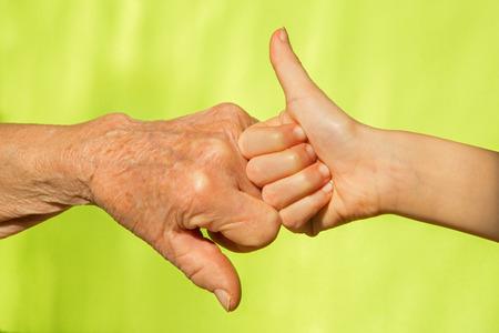 babyhood: hand of senior and child Stock Photo