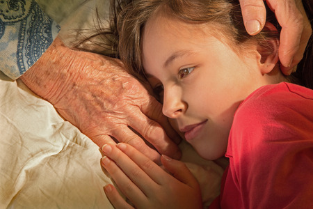 hands of grandmother and granddaughter in the morning photo