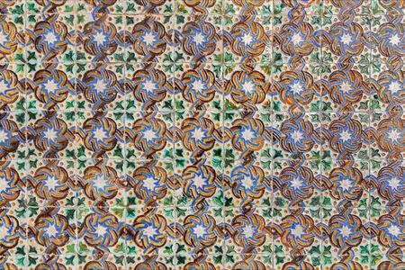 portico: SEVILLE, SPAIN - OCTOBER 28, 2014: The detail of tiles in mudejar style in courtyard of Casa de Pilatos.