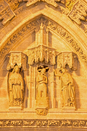 new entry: SEVILLE, SPAIN - OCTOBER 28, 2014: The detail of portal Puerta de Bautismo (Baptism of Christ) from 15. cent by N. Martinez and J. Norman on the Cathedral de Santa Maria de la Sede. Editorial