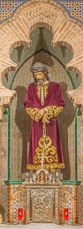 vested: SEVILLE, SPAIN - OCTOBER 28, 2014: The traditional vested Jesus Christ statue in bond in church Iglesia de San Pedro. Editorial