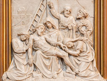 taken: VIENNA, AUSTRIA - DECEMBER 17, 2014: The Jesus is taken down from the cross relief as one part of Cross way cycle in Sacre Coeur church by R. Haas from end of 19. cent.