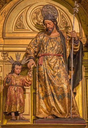 polychrome: SEVILLE, SPAIN - OCTOBER 29, 2014: The polychrome carved statue of st. Joseph in the church Iglesia de Santa Maria Magdalena from 17. cent.