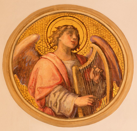 17 20: VIENNA, AUSTRIA - DECEMBER 17, 2014: The fresco of angel with the zither by Josef Kastner the younger from 20. cent in the church Muttergotteskirche.