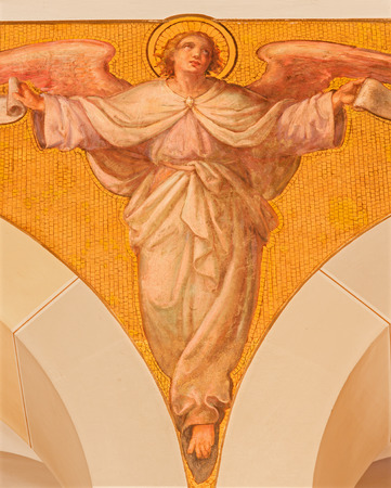 17 20: VIENNA, AUSTRIA - DECEMBER 17, 2014: The fresco of angel by Josef Kastner the younger from 20. cent in the church Muttergotteskirche.