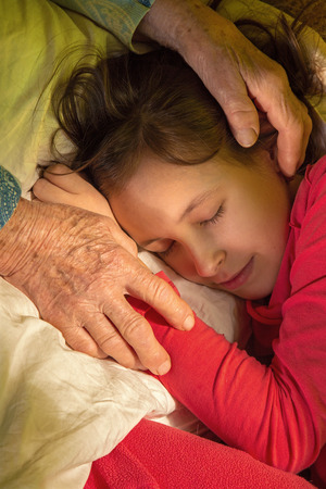 grandkid: hands of grandmother and granddaughter in the morning