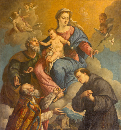 holy family: PADUA, ITALY - SEPTEMBER 10, 2014: The Holy Family and saints Nicholas and Anthony of Padua by unknown painter of 18. cent in the church of st. Nicholas.