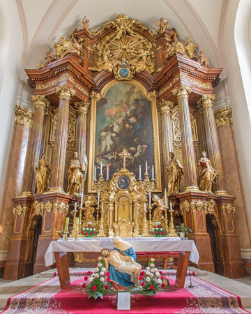 bible altar: TRNAVA, SLOVAKIA - MARCH 3, 2014: Main altar (1755-1757) in Jesuits church.
