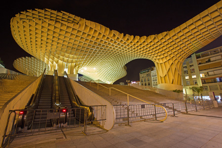 metropol parasol: SEVILLE, SPAIN - OCTOBER 28, 2014: Metropol Parasol wooden structure located at La Encarnacion square, designed by the German architect Jurgen Mayer Hermann and completed in April 2011.