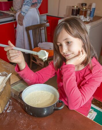 chagrin: young girl gustation at the cooking - unsuccess Stock Photo
