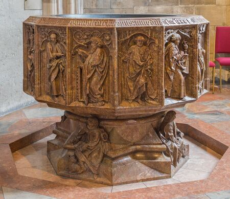 katherine: VIENNA, AUSTRIA - FEBRUARY 17, 2014: Lower part of gothic marble baptistery of St. Stephens cathedral or Stephansdom in st. Katherine chapel (1481).