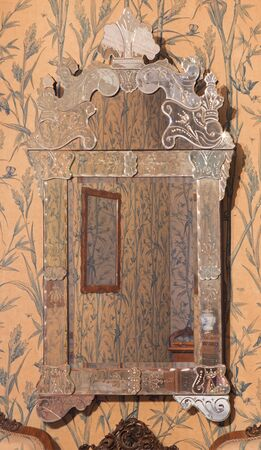 speculum: SAINT ANTON, SLOVAKIA - FEBRUARY 26, 2014: The venecian mirror in Saint Anton palace by unknown artist of 18. cent.