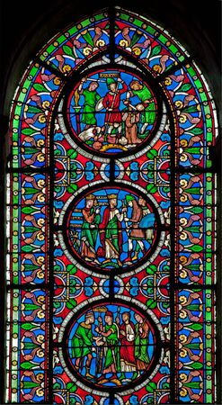 windowpane: PARIS FRANCE  JUNE 16 2011: The windowpane from Saint Denis gothic church with the scenes from French history.