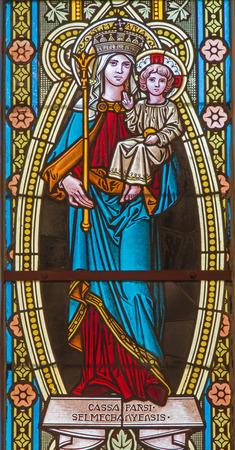 windowpane: BANSKA STIAVNICA, SLOVAKIA - FEBRUARY 5, 2015: The Madonna on the windowpane of st. Elizabeth church from 19. cent. by unknown artist. Editorial