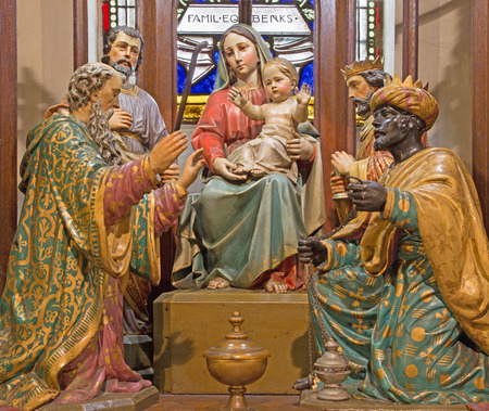 polychrome: BANSKA STIAVNICA, SLOVAKIA - FEBRUARY 5, 2015: The Three Magi carved and polychrome sculpture goroup on the main new gothic altar of st. Elizabeth church from 19. cent. by carver Jozef Kraus.