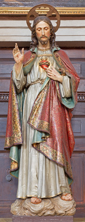 polychrome: BANSKA STIAVNICA, SLOVAKIA - FEBRUARY 5, 2015: The carved and polychrome statue of heart of Jesus Christ in parish church by unknown artist of 19. cent.