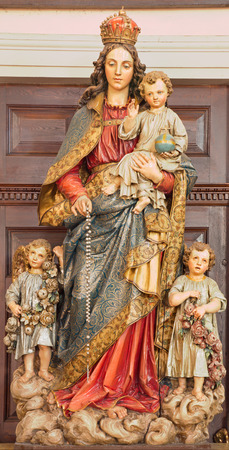 polychrome: BANSKA STIAVNICA, SLOVAKIA - FEBRUARY 5, 2015: The carved and polychrome statue of Madonna in parish church by unknown artist of 19. cent.