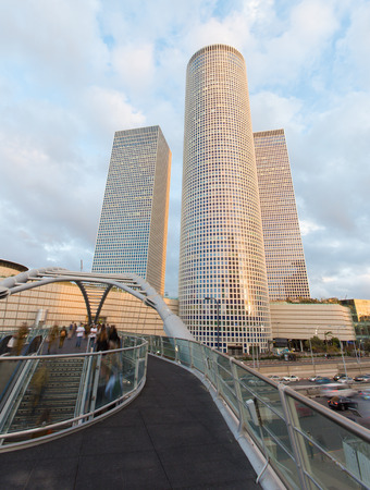 TEL AVIV, ISRAEL - MARCH 2, 2015: The skyscrapers of Azrieli Center in evening light by Moore Yaski Sivan Architects with measuring 187 m (614 ft) in height.