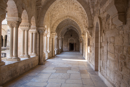 atrium: BETHLEHEM, ISRAEL - MARCH 6, 2015: The gothic corridor of atrium at St. Catharine church. Editorial