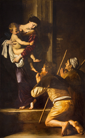 ROME, ITALY - MARCH 27, 2015: Madonna of Loreto and pilgrims by Caravaggio (1571 - 1610) in Basilica di Sant Agostino (Augustine).