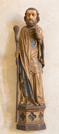 apostle: SPISSKY CASTLE, SLOVAKIA - JULY 19, 2014: The gothic carved statue of apostle Jude Thaddeus from castle chapel.