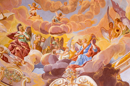 jesus in heaven: BANSKA STIAVNICA, SLOVAKIA - FEBRUARY 20, 2015: The detail of fresco on cupola in the middle church of baroque calvary by Anton Schmidt from years 1745. Angels with the music instruments.