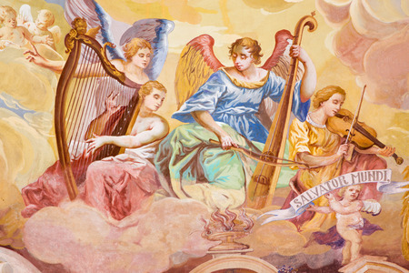 BANSKA STIAVNICA, SLOVAKIA - FEBRUARY 20, 2015: The detail of fresco on cupola in the middle church of baroque calvary by Anton Schmidt from years 1745. Angels with the music instruments.