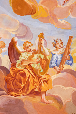 anton: BANSKA STIAVNICA, SLOVAKIA - FEBRUARY 20, 2015: The detail of fresco on cupola in the middle church of baroque calvary by Anton Schmidt from years 1745. Angels with the music instruments.