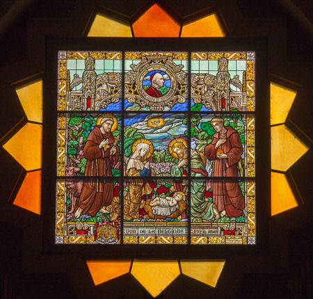 JERUSALEM, ISRAEL - MARCH 5 , 2015: The Nativty scene on the rosette in sanctuary of st. Catharine church by P. M. Ganton  from year 1926.