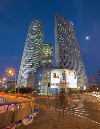 azrieli center: TEL AVIV ISRAEL  MARCH 2 2015: The skyscrapers of Azrieli Center in evening dusk by Moore Yaski Sivan Architects with measuring 187 m 614 ft in height.