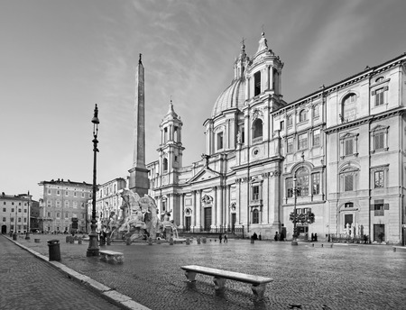 bernini: ROME ITALY  MARCH 27 2015:  Piazza Navona in morning and Fontana dei Fiumi by Bernini and Egypts obelisk and Santa Agnese in Agone church