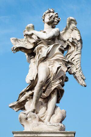 bernini: ROME ITALY  MARCH 27 2015:  Rome  Angel with the superscription by Gian Lorenzo Bernini 1598  1680 and son Paolo original at SantAndrea delle Fratte copy by Giulio Cartari.