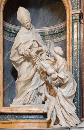 bible altar: ROME ITALY  MARCH 26 2015: The marble sculpture of St. Thomas of Villanova in his side chapel by  Melchiorre Caffa 1635  1667 in church  in Basilica di Sant Agostino Augustine. Editorial