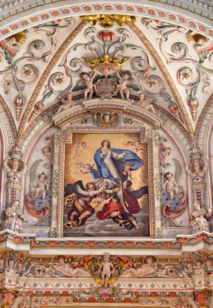 GRANADA, SPAIN - MAY 31, 2015: The detail of fresco in baroque sanctuary  in church Monasterio de la Cartuja with The Assumption of the Virgin painting by Pedro Atanasio Bocanegra (17. cent.) Editorial