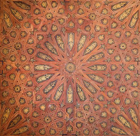 mudejar: GRANADA, SPAIN - MAY 30, 2015: The detail of mudejar wood ceiling in Nasrid palace.