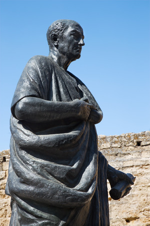 seneca: CORDOBA, SPAIN - MAY 25, 2015: The statue of philosopher Lucius Annaeus Seneca the Younger by Amadeo Ruiz Olmos (1913 - 1993) before of medieval gate Puerta del Almodovar. Editorial