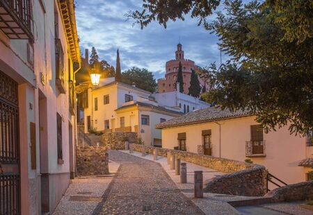 ascent: Granada - The ascent to Alhambra palace across the old street in morning dusk.