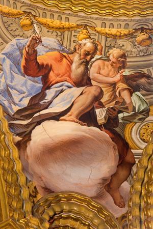 evangelist: GRANADA, SPAIN - MAY 31, 2015: The fresco of St. Matthew the evangelist in baroque sanctuary (Sancta Sanctorum) in church Monasterio de la Cartuja by Antonio Palomino (early of 18. cent.)
