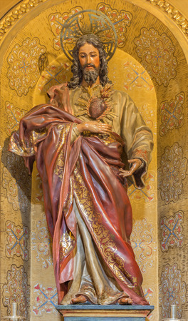 anton: GRANADA, SPAIN - MAY 29, 2015: The carved statue The Heart of Jesus Christ  in Iglesia de san Anton by unknown artist.