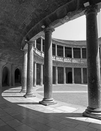 atrium: GRANADA, SPAIN - MAY 30, 2015: The columns and atrium of Alhambra palace of Charles V-