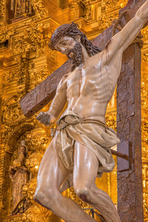 descending: CORDOBA, SPAIN - MAY 26, 2015: The Christ descending from the cross statue in church of Monastery of st. Ann and st.Joseph Convento de Santa Ana y San Jose.