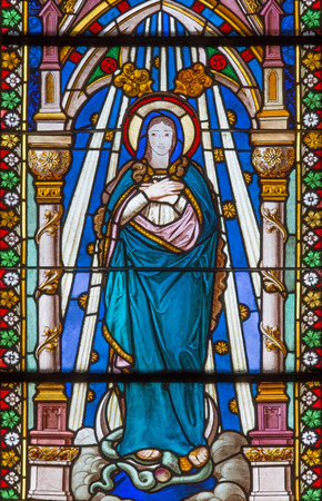 immaculate: BANSKA BELA, SLOVAKIA - FEBRUARY 5, 2015: The Immaculate Conception on the windowpane of St. John the Evangelist church from end of 19. cent.