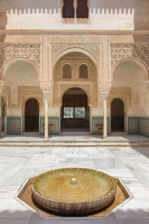 mudejar: GRANADA, SPAIN - MAY 30, 2015: One of atrium in mudejar Nasrid palace